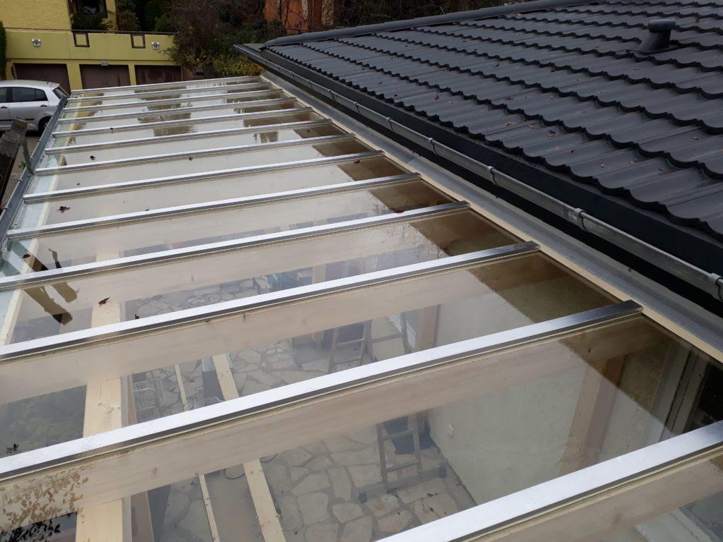 Neubau einer Terrassenüberdachung mit Glasdach